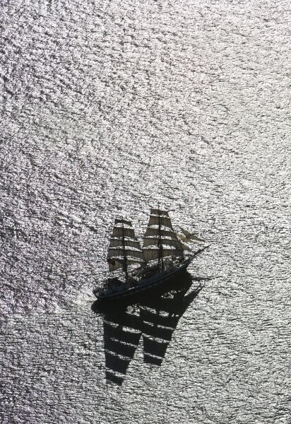 Aerial view of the ocean with tall ship, sailing boat