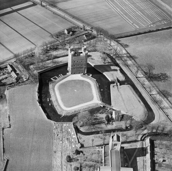TATTERSHALL CASTLE, Lincolnshire. Aerial view of the tower and moats, 20th March 1951. Aerofilms Collection (see Links)