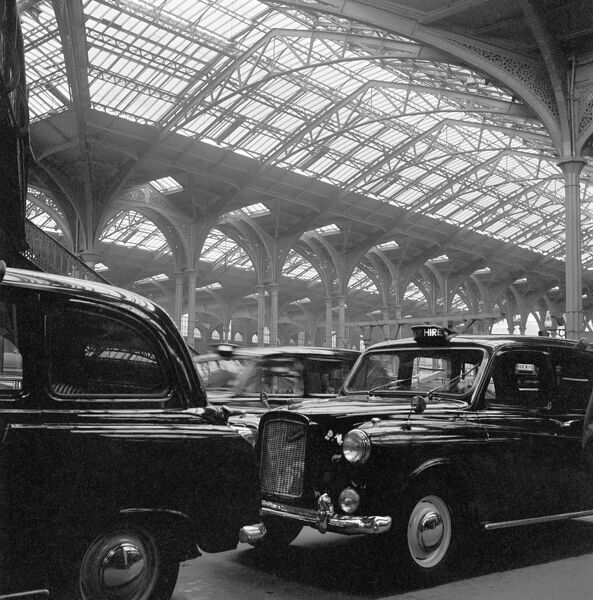 LIVERPOOL STREET STATION, London. Taxi rank with black cabs at Liverpool Street railway station with the roof structure visible behind. John Gay. Date range: 1960-1972