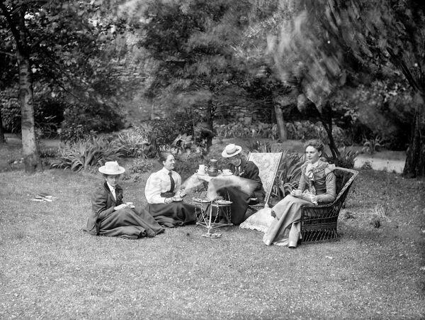 Four female students taking tea in the grounds of Somerville College, Oxford, Oxfordshire. The tea party was an important part of college social life in the Late Victorian period. Henry Taunt 1895