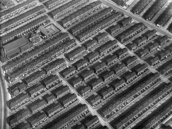 Serried ranks of close-packed working class housing in Leeds, West Yorkshire, photographed in 1928. By the 1930s much of Leeds Victorian housing stock were regarded as slums. Aerofilms Collection (see Links)