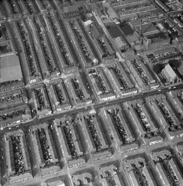 Preston, Lancashire. Aerial view of terraced houses, a mill and a church. Photographed by Aerofilms in 1971
