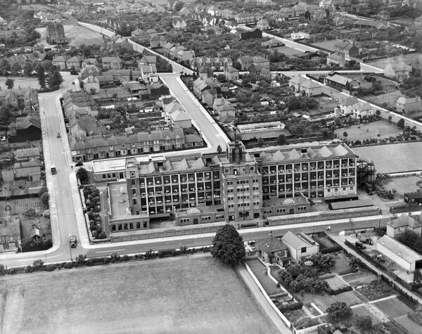 TIMPSONS FACTORY, Kettering, Northamptonshire. Kettering, along with a number of Northamptonshire towns specialised in footwear manufacture. This modern-looking factory produced shoes and boots was photographed in June 1937. Aerofilms Collection