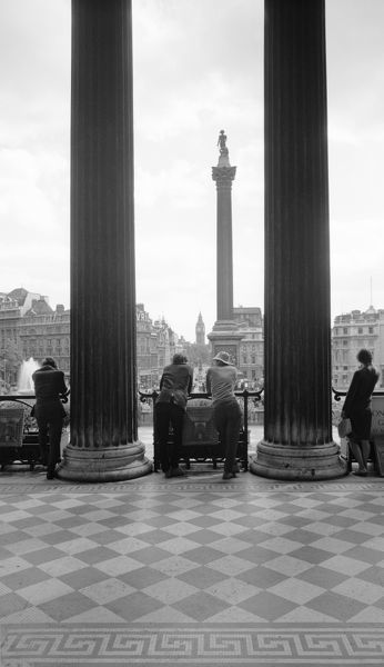 TRAFALGAR SQUARE, Westminster, Greater London. Trafalgar Square and Nelson's Column seen from the portico of the National Gallery. The 'Big Ben' clock tower can be seen in the distance. Photographed by Eric de Mare between 1945 and 1980