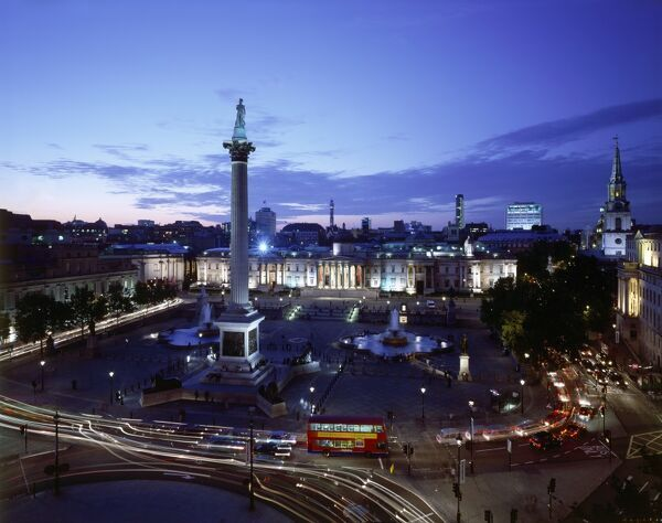 TRAFALGAR SQUARE, City of Westminster, London. An elevated view of the square showing Nelson's Column & the National Gallery at dusk / night
