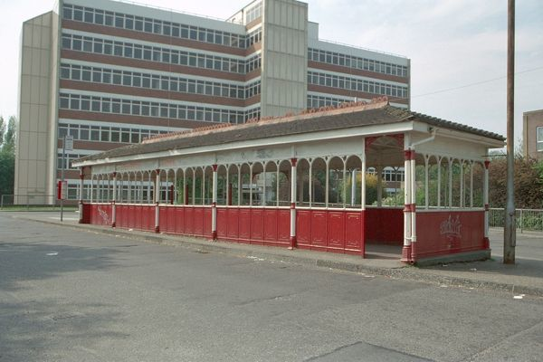 One of only two remaining cast-iron tram shelters in Portsmouth. Now in use as a bus shelter. IoE 475034