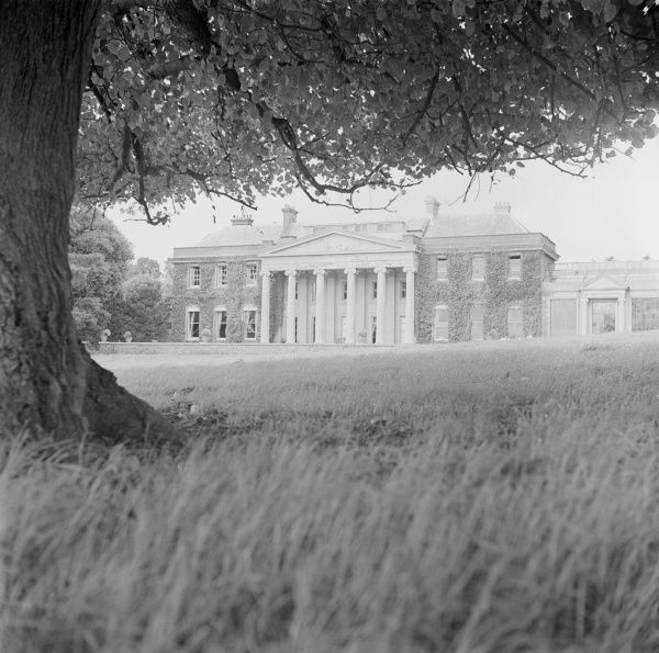 TRELISSICK, Feock, Cornwall. The entrance front of Trelissick, Feock, with its pedimented portico. It was built by P F Robinson circa 1825. Pevsner called it 'the severest neo-Greek mansion in Cornwall'. Photographed by Eric de Mare between 1945