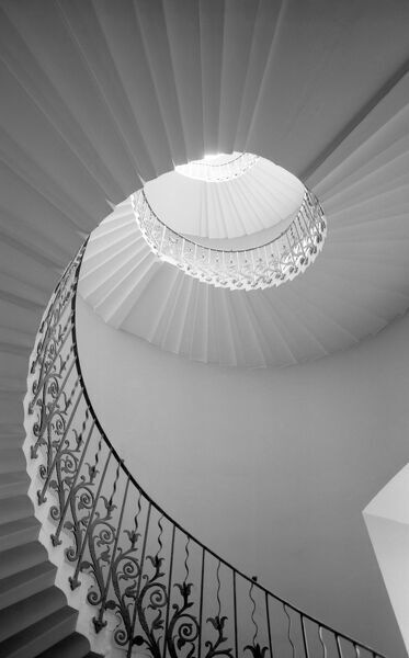 QUEEN'S HOUSE, Romney Road, Greenwich, London. Interior detail view of Queen's House, Greenwich showing a tulip / spiral staircase. Photographed by Eric de Mare. Date range: 1945 - 1980