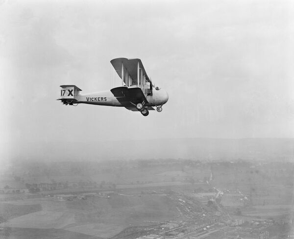 Aerial view of what appears to be a Vickers Vimy Commercial aircraft in flight (with the unusual registration 17-X on the tail fin). The same basic airframe was used for the Vickers Vernon, adopted by the RAF as a cargo aircraft between 1921 and 1927