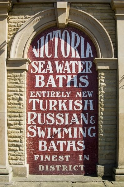 Southport, Merseyside. Played In series: Liverpool. Detail of mosaic sign for Victoria Sea Water Baths at Southport Esplanade