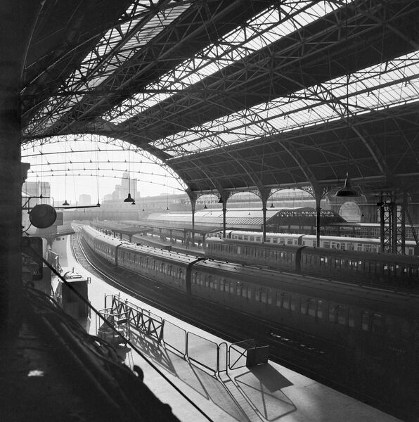 VICTORIA STATION, Westminster, London. Elevated view inside the train shed at Victoria railway station looking along a near empty platform and out towards the city. John Gay. Date range: 1960-1972