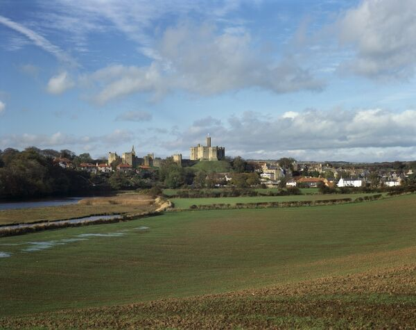 WARKWORTH CASTLE, Northumberland. Distant view of castle from the east