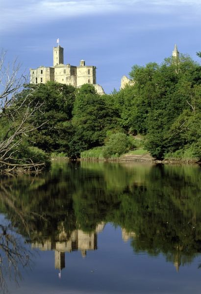 WARKWORTH CASTLE, Northumberland. A view of the castle from footpath along the River Coquet