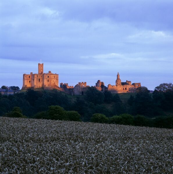 WARKWORTH CASTLE, Northumberland. A distant view from the West at sunset