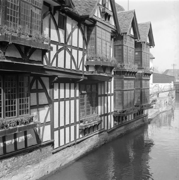 THE WEAVERS, Canterbury, Kent. These timber-framed buildings on King's Bridge were adapted in the 17th century for the looms of the Walloon weavers. The river was needed for finishing cloth. Fulling mills were later adapted for paper-making