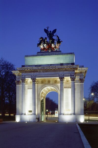 THE WELLINGTON ARCH, London. A floodlit view from the west at night. The triumphal arch was designed by Decimus Burton and was completed in 1830