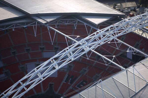 WEMBLEY STADIUM, London. Close up aerial view showing section of the roof, interior and arch