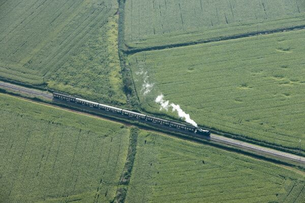 Aerial view of a steam train on the West Somerset Railway near Dunster, Somerset