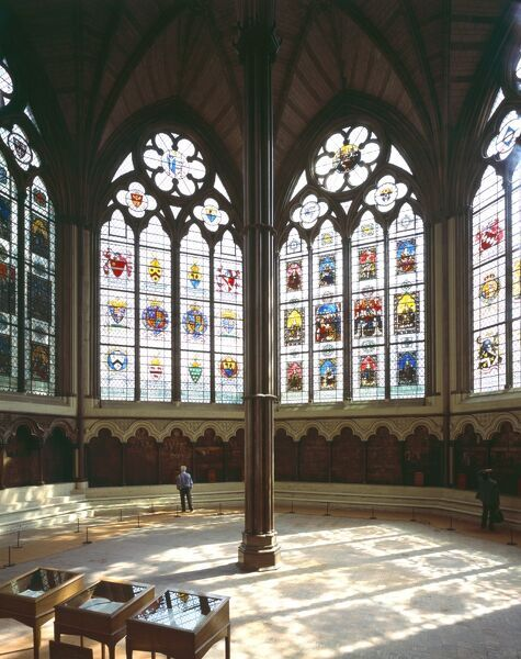 WESTMINSTER ABBEY CHAPTER HOUSE, London. Interior view from the North showing stained glass windows