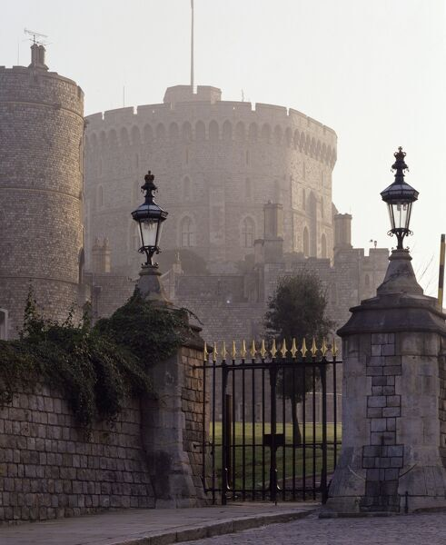 WINDSOR CASTLE, Berkshire. A misty sunrise view of the Round Tower, built 1170
