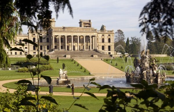 WITLEY COURT AND GARDENS, Worcestershire.The house, fountain and parterre garden viewed through trees