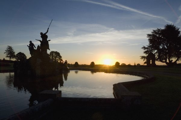 WITLEY COURT AND GARDENS, Worcestershire. The pool of the fountain at sunrise