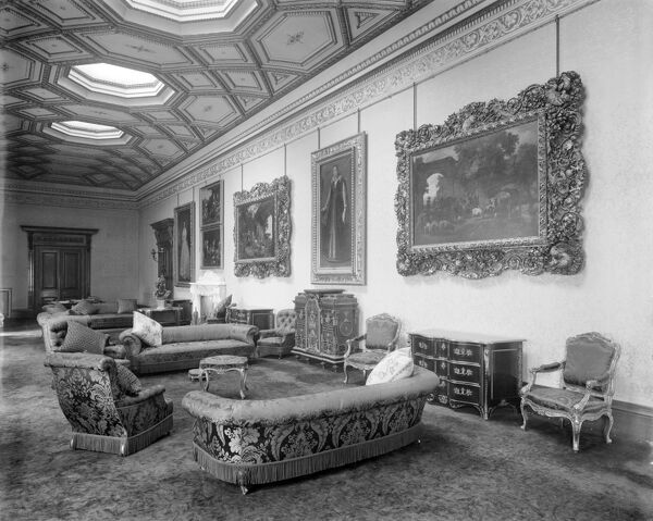WITLEY COURT, Great Witley, Worcestershire. Interior view of the Picture Gallery with a series of paintings and fine furniture. The high ceiling and octagonal roof lights made the Picture Gallery a light and airy space. Photographed by Bedford Lemere in 1920
