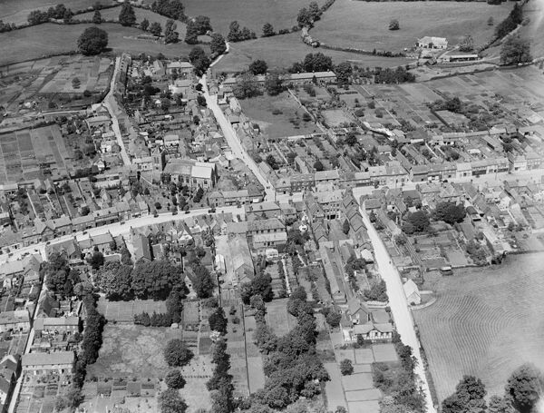 WOOTTON BASSETT, Wiltshire. Aerial view of the Church of St. Bartholomew and All Saints, Wood Street, High Street and Station Road, June 1930. Aerofilms Collection (see Links)