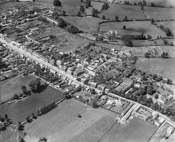 WOOTTON BASSETT, Wiltshire. Aerial view of the Wesleyan Methodist Chapel, Coxstalls and the High Street, June 1930. Aerofilms Collection (see Links)