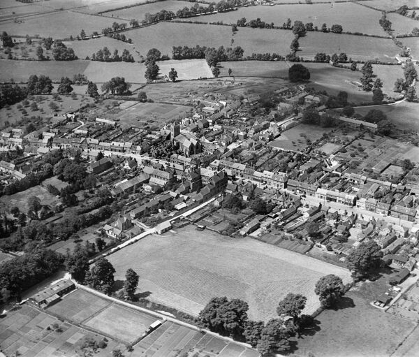 WOOTTON BASSETT, Wiltshire. Aerial view of the Church of St. Bartholomew and All Saints, High Street and Station Road, June 1930. Aerofilms Collection (see Links)