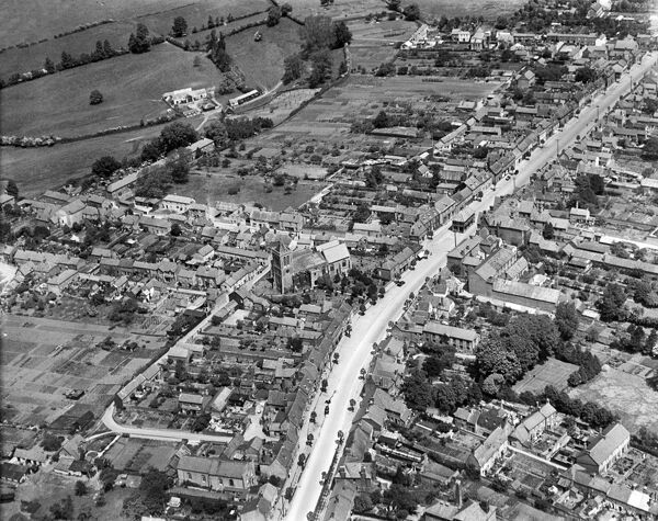 WOOTTON BASSETT, Wiltshire. Aerial view of the Church of St. Bartholomew and All Saints and the High Street, June 1930. Aerofilms Collection (see Links)