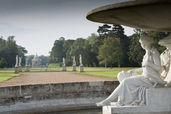 WREST PARK HOUSE AND GARDENS, Bedfordshire. View of one of the statues found on the marble fountain, looking towards Long Water