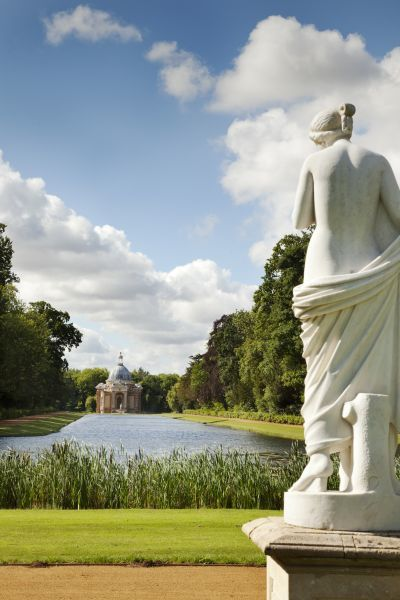WREST PARK HOUSE AND GARDENS, Bedfordshire. The Archer Pavilion and Long Water with statue in foreground