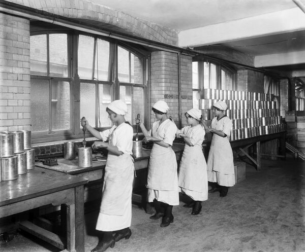 CADBY HALL, Hammersmith Road, London. Female workers at Cadby Hall food factory making Christmas puddings for troops fighting in the First World War. Photographed in Sept / Oct 1918 by Bedford Lemere and Co
