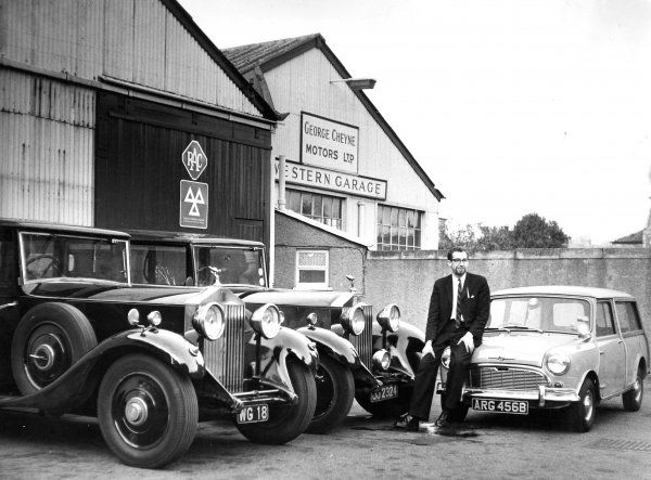 ASSISTANT GENERAL MANAGER OF ABERDEEN'S COSMO 2 CINEMA AND THE PALAIS BALLROOM, DIAMOND STREET, ABERDEEN WITH HIS NEW MORRIS TRAVELLER AND HIS TWO ROLLS ROYCE LIMOUSINES, OUTSIDE CHEYNES GARAGE, 60, GREAT WESTERN ROAD, ABERDEEN PHOTO: EARLY 1960s