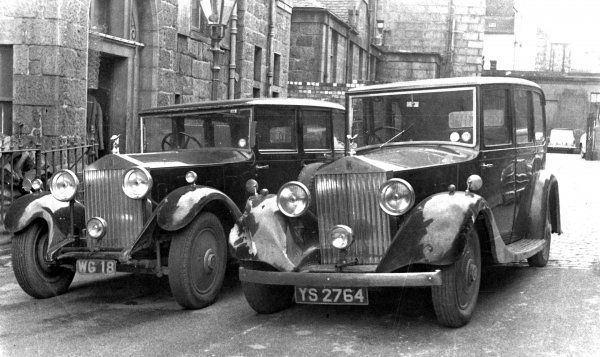 WG 18 - A 1933 ROLLS ROYCE LIMOUSINE OWNED BY TOMMY HUNTER SON OF THE FAMOUS ALEX 'COCKY' HUNTER, SECOND - HAND DEALER, OUTSIDE THEIR PREMISES - THE OLD SICK CHILDRENS HOSPITAL, CASTLEHILL TERRACE, ABERDEEN WITH YS 2764, A 1935 ROLLS