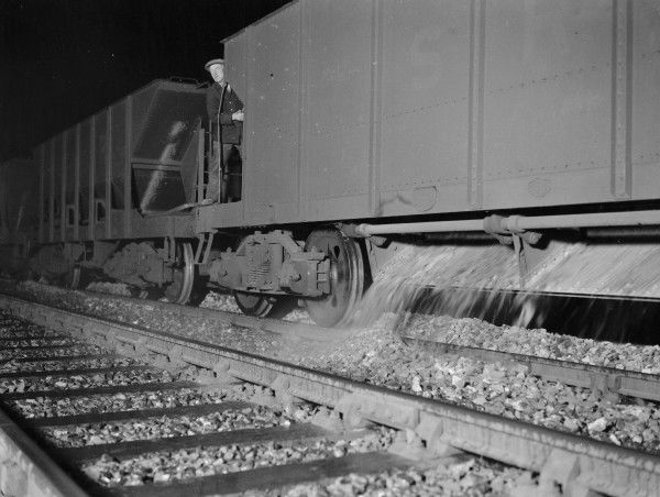 Ballast dropping from a Southern Railway 40 ton ballast hopper onto the track