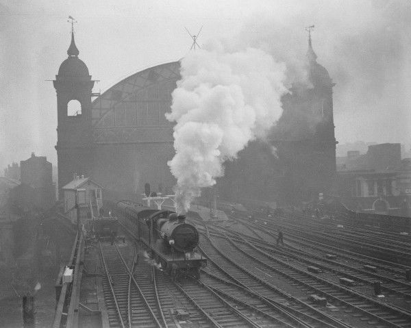 A Class L 4-4-0 of the Southern Railway leaving Cannon Street Station and crossing the bridge over the River Thames