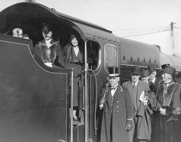 The Mayor and Mayoress of Wimbledon on the footplate of Southern Railway Lord Nelson Class 4-6-0 locomotive Lord Anson with its designer Richard Edward Lloyd Maunsell (in bowler hat) close by