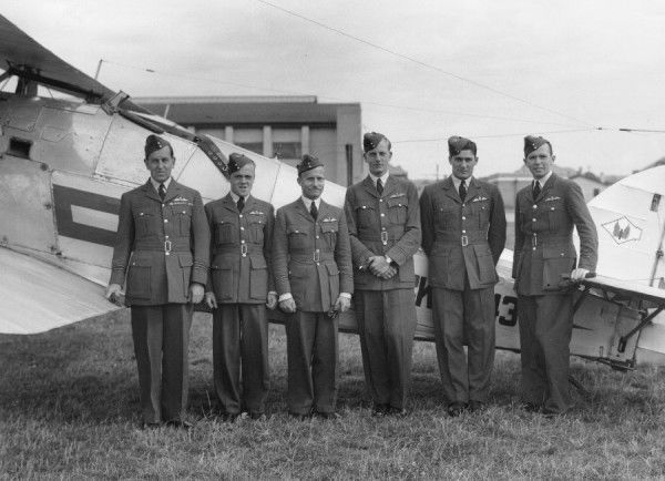 Pilots of 1 Squadron, including Wing Commander C W Hill, Flight Lieutenant E M Donaldson, Flying Officer H E C Boxer and Pilot Officer P P Hanks, RAF Tangmere, 1937