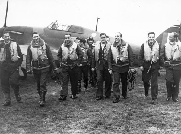 John Alexander Kent and the Polish pilots of 303 Squadron walking away from Hawker Hurricane during the Battle of Britain, 1940
