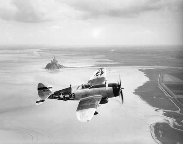 Republic P-47D Thunderbolt (42-25845 R3-G) of 410th Fighter Squadron USAAF in flight near Mont St Michael, Normandy, 26 August 1944