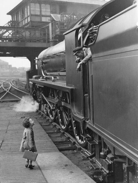 The famous photograph of a little boy talking to the locomotive crew, Waterloo Station 7 June 1924, used in Southern Railway's advertising campaign