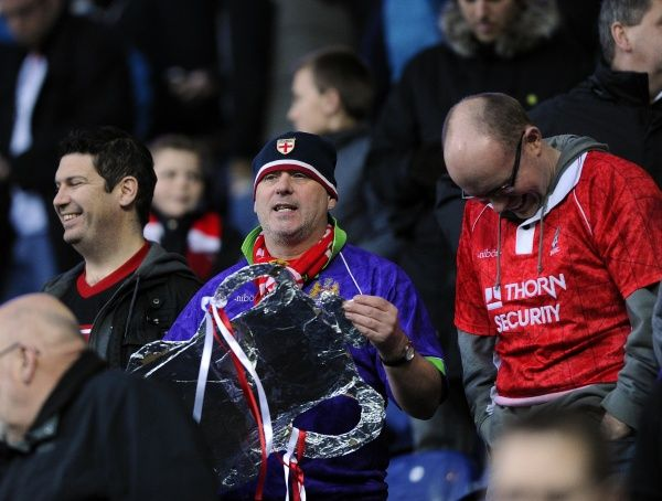 A Bristol City Fan looks for a new use for his Fake FA Cup as he sees his side knocked out of the 3rd Round - Photo mandatory by-line: Joe Meredith/JMP - Tel: Mobile: 05/01/2013 - Blackburn Rovers v Bristol City - SPORT - FOOTBALL - FA Cup