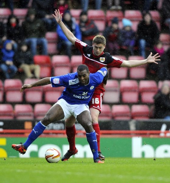 Bristol City's Steven Davies battles for the ball with Leicester City's Wes Morgan - Photo mandatory by-line: Joe Meredith/JMP - Tel: Mobile: 12/01/2013 - Bristol City v Leicester City - SPORT - FOOTBALL - Championship - Bristol - Ashton Gate