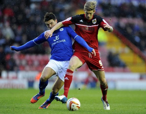 Bristol City's Jon Stead battles for the ball with Leicester City's Matthew James - Photo mandatory by-line: Joe Meredith/JMP - Tel: Mobile: 12/01/2013 - Bristol City v Leicester City - SPORT - FOOTBALL - Championship - Bristol - Ashton Gate