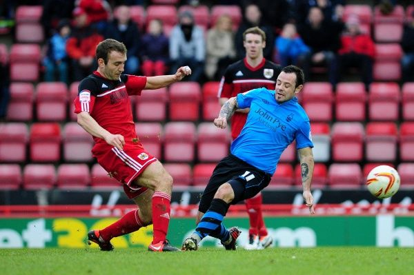 Nottingham Forest's Andy Reid challenges Bristol City's Liam Kelly - Photo mandatory by-line: Dougie Allward/JMP - Tel: Mobile: 09/02/2013 - SPORT - FOOTBALL - Ashton Gate - Bristol - Bristol City V Nottingham Forest - Npower Championship