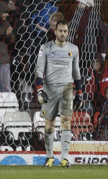 Watford's Manuel Almunia cuts a dejected figure after Bristol City's Gregg Cunningham scores the opening goal - Photo mandatory by-line: Dougie Allward/JMP - Tel: Mobile: 29/01/2013 - SPORT - FOOTBALL - Ashton Gate - Bristol - Bristol City V