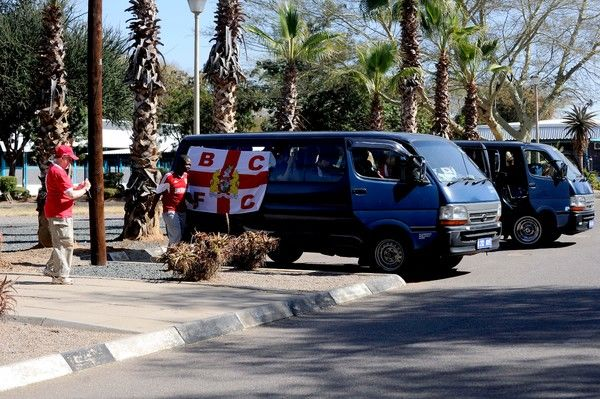 A Bristol City flag is put onto a mini-bus as fans travel to the Botswana National Stadium - Photo mandatory by-line: Dougie Allward/JMP - Mobile: 21/07/2014 - SPORT - FOOTBALL - Gaborone - Botswana - Extension Gunners v Bristol City