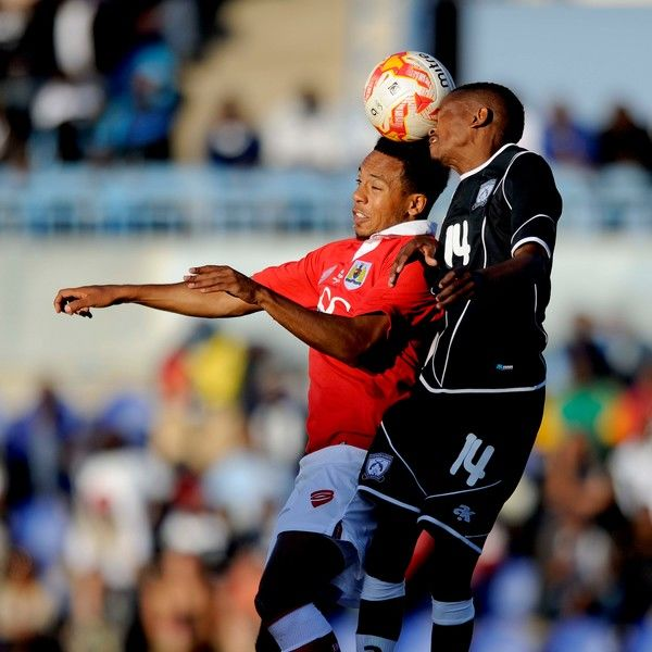 Bristol City?s new signing, Korey Smith challenges Finikie Mothibi to the ball - Photo mandatory by-line: Dougie Allward/JMP - Mobile: 21/07/2014 - SPORT - FOOTBALL - Gaborone - Botswana - Extension Gunners v Bristol City